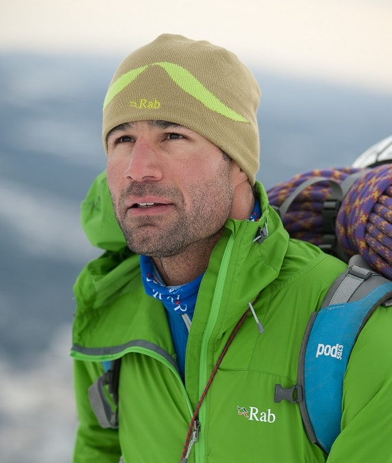 Image of a man wearing bright green cold weather gear