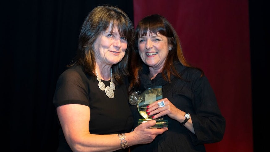 Professor Karen Holford presents Professor Sioned Davies with an award