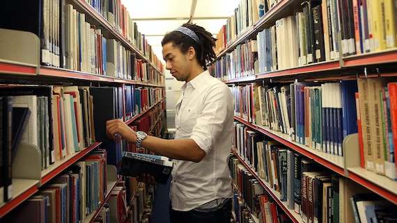 Male PG student in the library