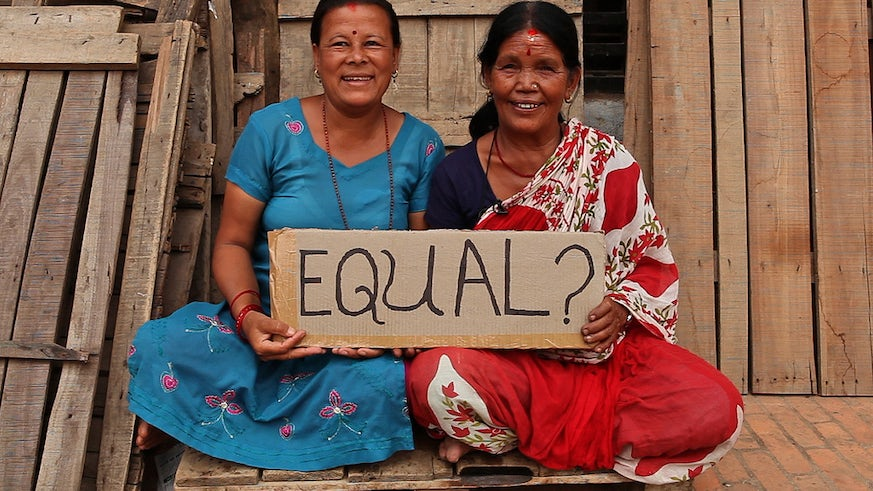 Women in Nepal holding an equality sign