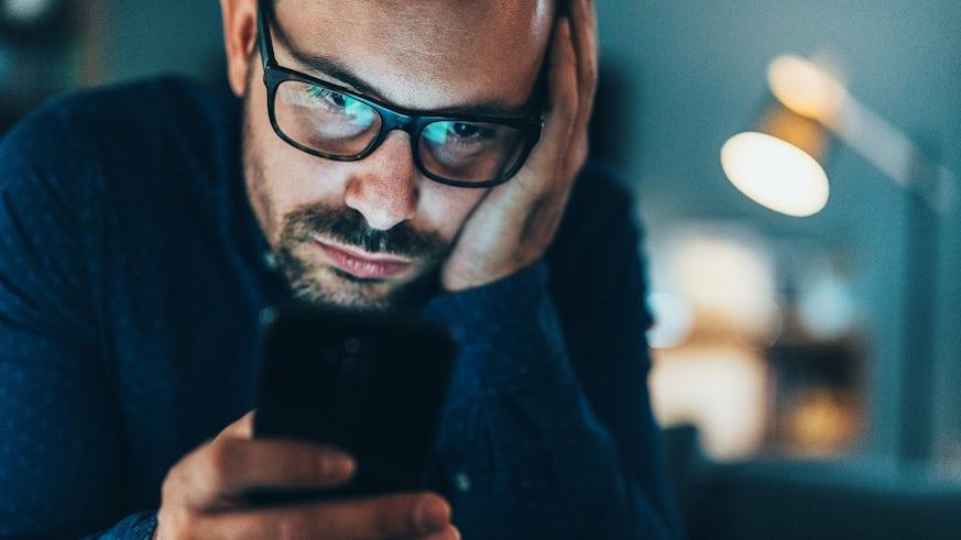 Man using his phone in lockdown stock image