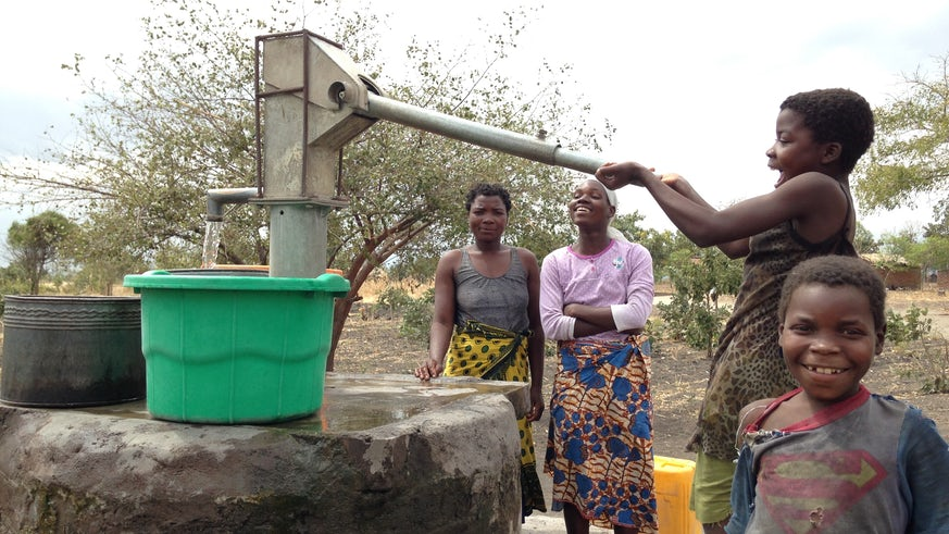 Villagers pumping water from a borehole in southern Malawi