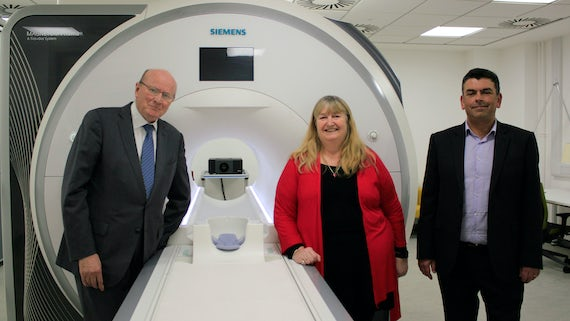 Julie James AM, Professor Derek Jones and Professor Krish Singh with MRI scanner