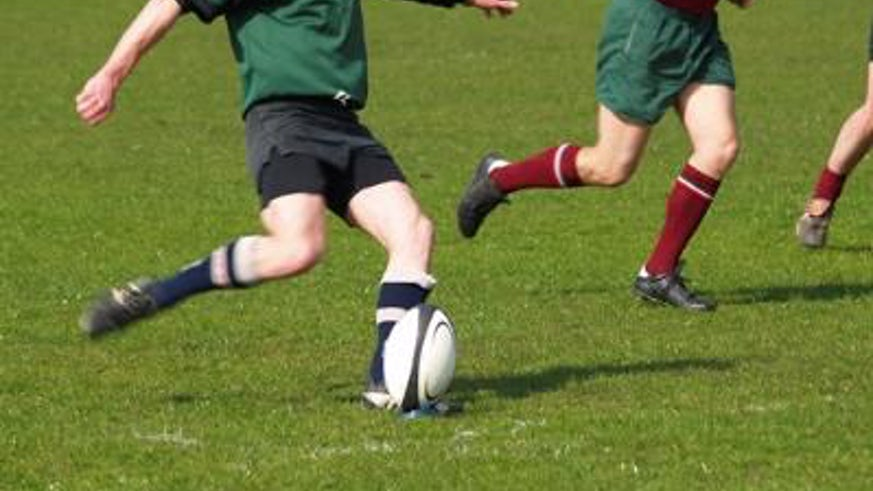 Lower half of footballers playing football