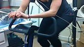 A photo of a person on an exercise bike