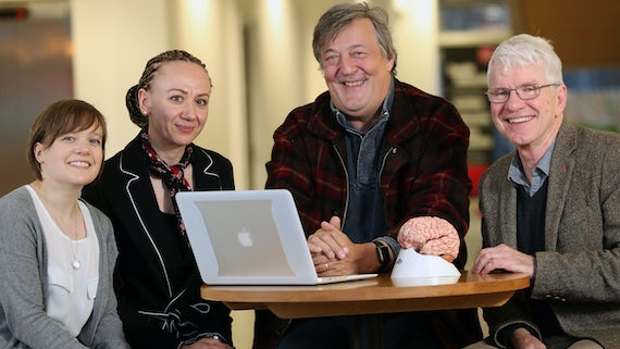 photograph of Stephen Fry with team at Neuroscience and Mental Health Research Institute