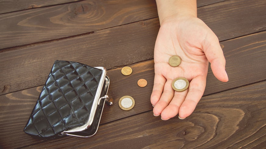 Hand holding change from purse