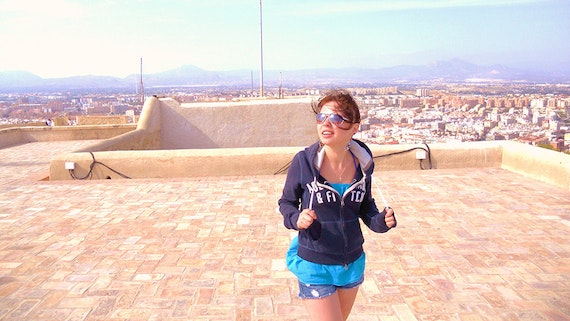 Standing on a rooftop in a Spanish city