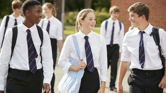 Secondary school pupils in playground
