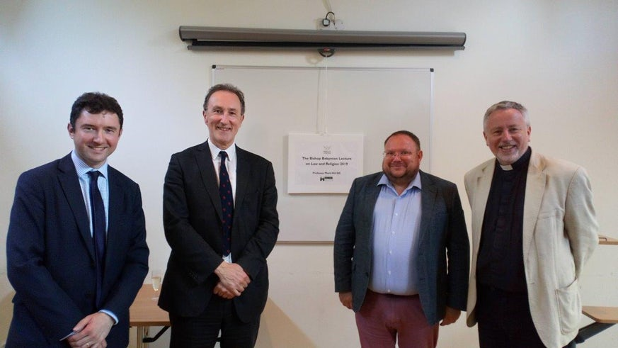 Professor Norman Doe and Professor Mark Hill (centre) pictured with Christopher Jones (Solicitor, Harris and Harris, and a Cardiff law graduate), and Very Revd Dr John Davies, Dean of Wells Cathedral