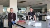 Two volunteers sat in the teaching labs in School of Biosciences