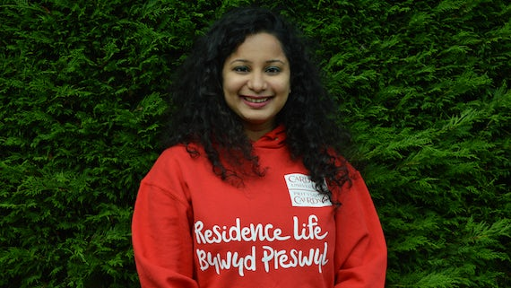 Student wearing a Residence Life hoody
