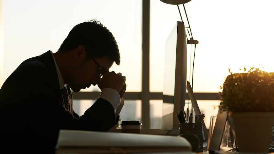 Silhouette of stressed office worker