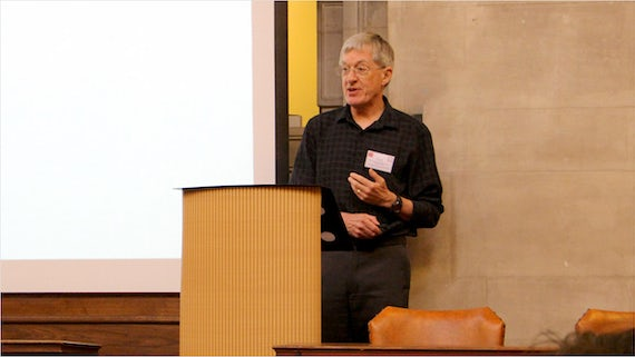 Professor Chris Pountain speaking at a lectern