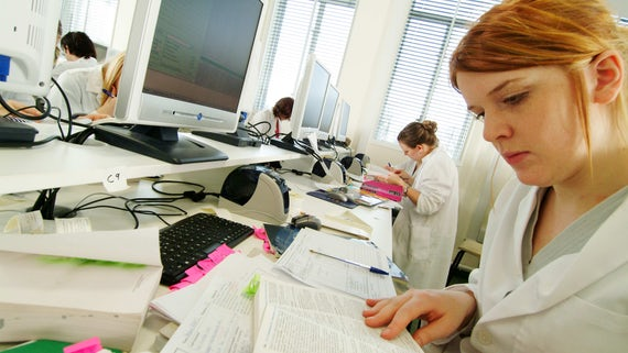 Student working in white coat