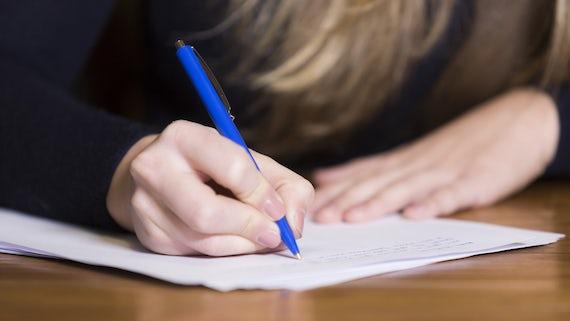 Female student writing essay