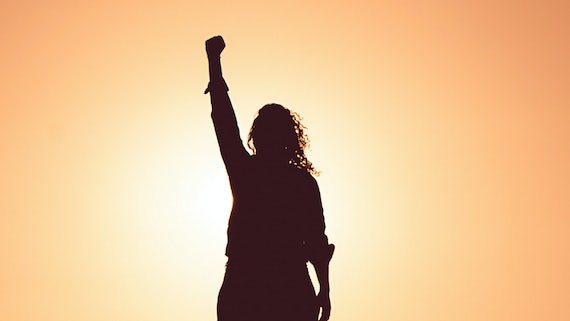Silhouette of person with fist in the air