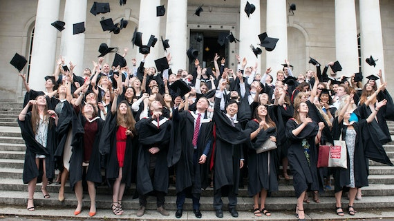 Graduates on steps of Bute Building