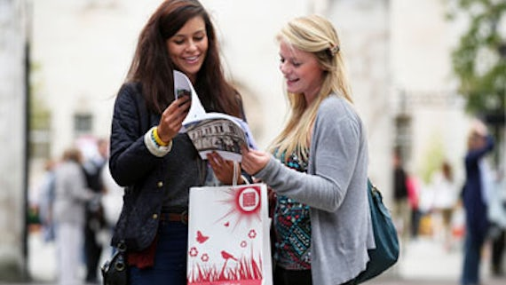 Students browsing brochure