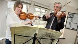 Claire Holden and Robin Stowell playing violin