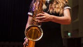 Student playing saxophone