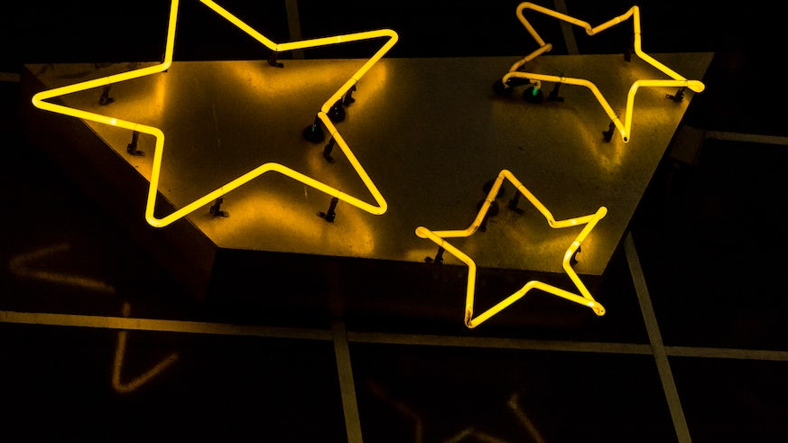 Low angle photograph of neon stars