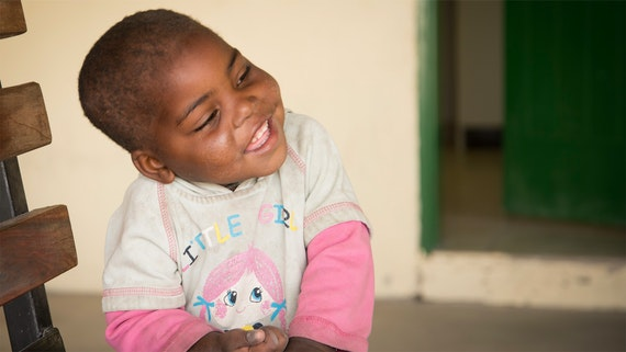 Child smiling at Bunya Health Centre in Northern Namibia