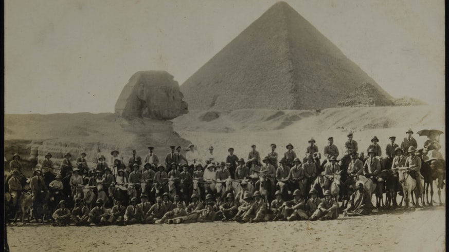 Soldiers in front of the sphinx and pyramid at Giza