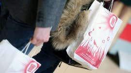 Hands gripping Cardiff University Open Day bags