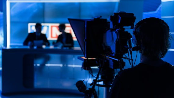 News readers in TV studio