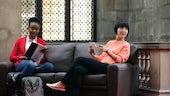 Postgraduate students on sofa