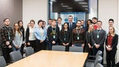 Dr Einion Dafydd and students with Adam Price AM during a visit to the Senedd.