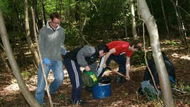 Students collecting samples from the forest floor