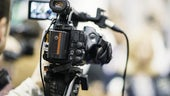 A close up picture of a TV camera
