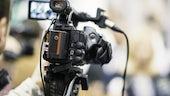 A close up picture of a TV camera