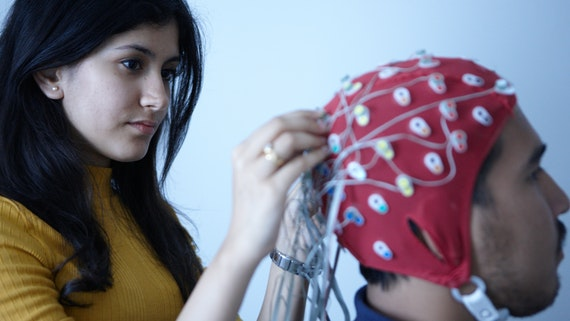 Two neuroscience summer school students taking part in neuroscience research activities.