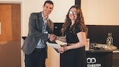 Dr Rick Short, NDA Research Manager, presenting Danielle with the best oral presentation award.