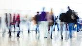 people walking in corridor blurred colours