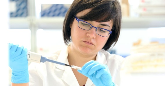 A researcher working in the HEB lab