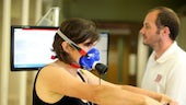 Physiotherapist works with patient on cardiorespiratory equipment