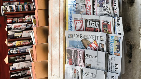 European newspapers on a news stand