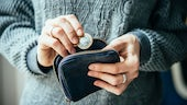 Woman sorting coins in her purse stock image