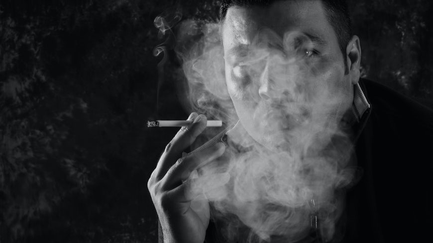 Image of person smoking