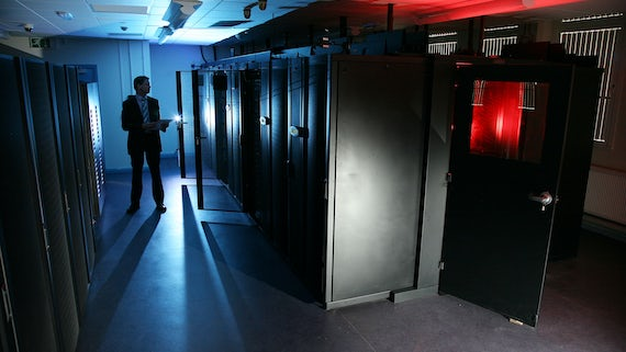 Man inspecting of supercomputers
