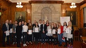Image shows large group of undergraduate and postgraduate students holding certificates alongside the Head of the School of Geography and Planning