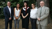 Image of Catherine King in a graduation gown with members of Cardiff University staff