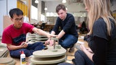 Students working with wooden materials