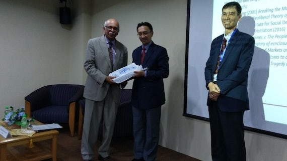 Dr Rawindaran Nair presented with memento
