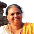 A profile image of Vishakha Kawathekar smiling.