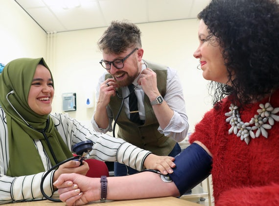 student taking blood pressure with Martyn and Lisa
